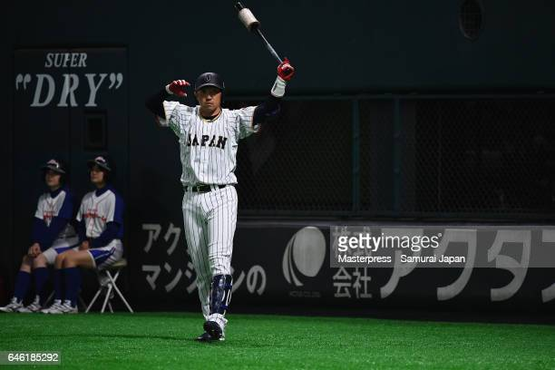 Outfielder Seiichi Uchikawa of Japan warms up in the bottom of the seventh inning during SAMURAI JAPAN Sendoff Friendly Match between Japan and CPBL...