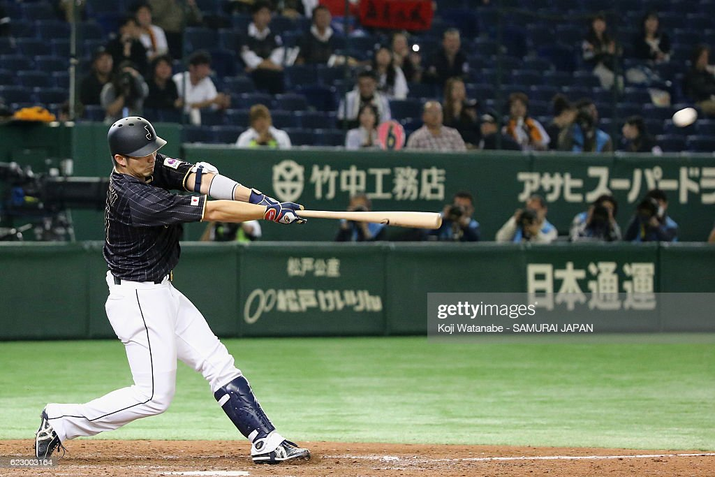 Outfielder Seiya Suzuki of Japan hits a grand slam in the tenth inning during the international friendly match between Netherlands and Japan at the Tokyo Dome on November 13, 2016 in Tokyo, Japan.