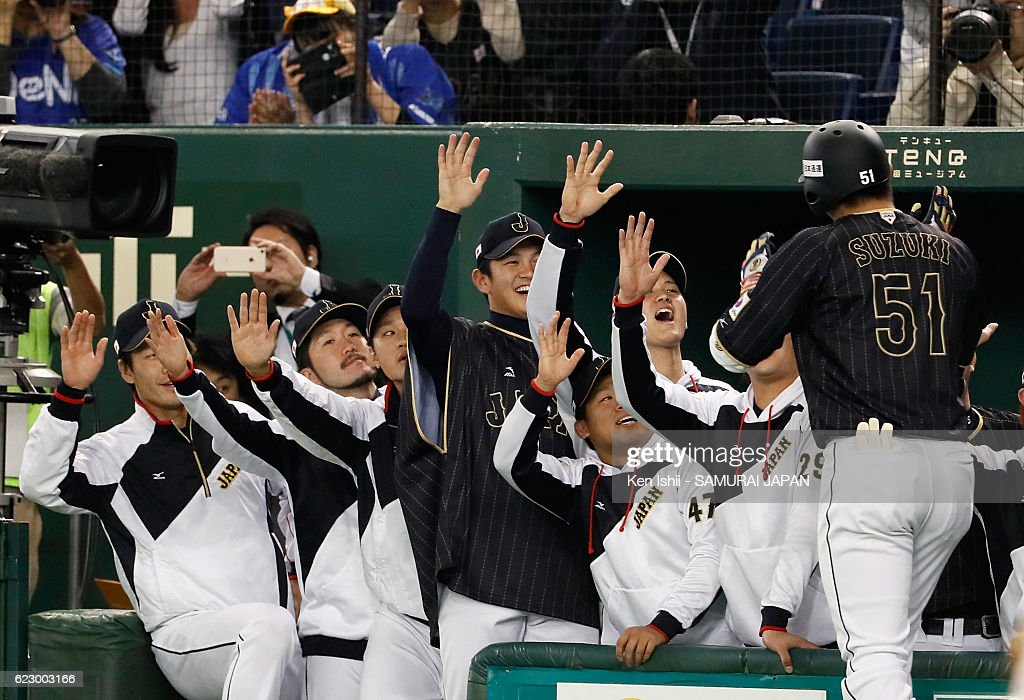 Outfielder Seiya Suzuki of Japan is congratulated after hitting a grand slam in the tenth inning during the international friendly match between Netherlands and Japan at the Tokyo Dome on November 13, 2016 in Tokyo, Japan.