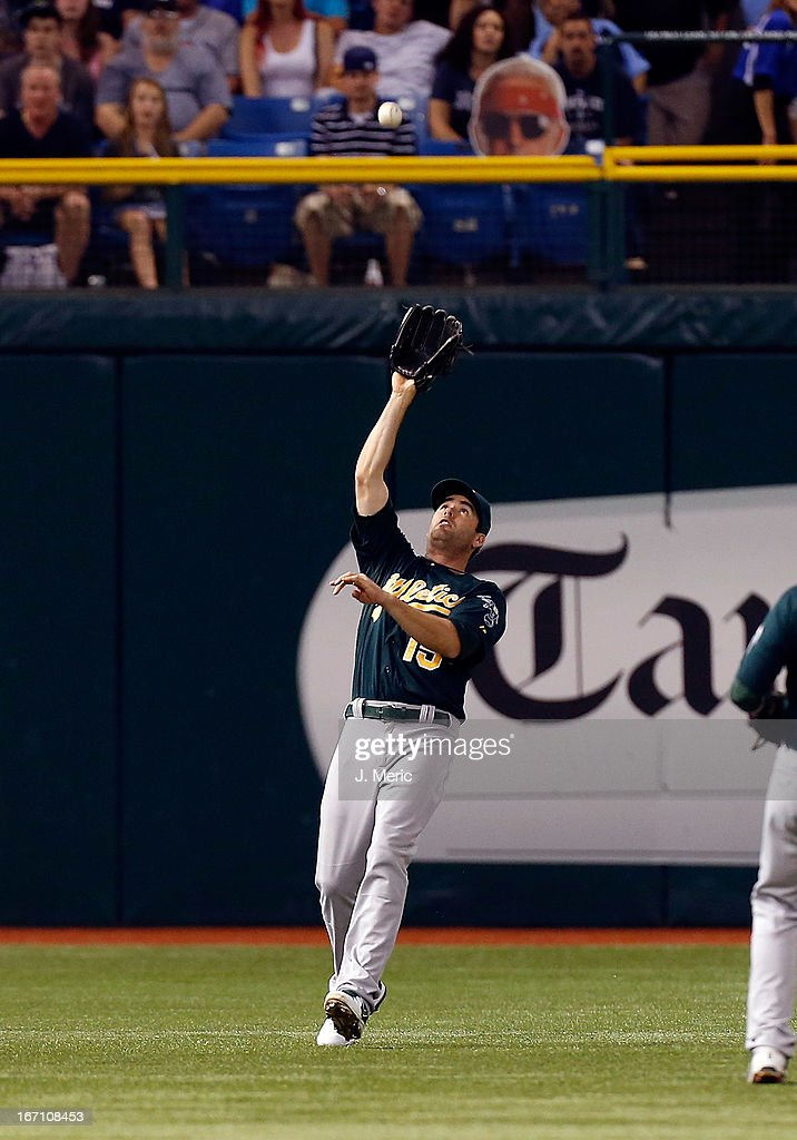 Outfielder <a gi-track='captionPersonalityLinkClicked' href=/galleries/search?phrase=Seth+Smith&family=editorial&specificpeople=3190174 ng-click='$event.stopPropagation()'>Seth Smith</a> #15 of the Oakland Athletics catches a fly ball against the Tampa Bay Rays during the game at Tropicana Field on April 20, 2013 in St. Petersburg, Florida.