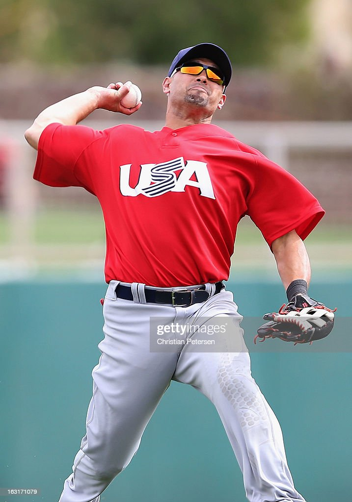 Outfielder <a gi-track='captionPersonalityLinkClicked' href=/galleries/search?phrase=Shane+Victorino&family=editorial&specificpeople=576251 ng-click='$event.stopPropagation()'>Shane Victorino</a> #50 of Team USA throws to home plate for the out against Dayan Viciedo (not pictured) of the Chicago White Sox during the spring training game at Camelback Ranch on March 5, 2013 in Glendale, Arizona.