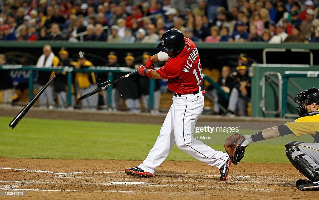 Outfielder <a gi-track='captionPersonalityLinkClicked' href=/galleries/search?phrase=Shane+Victorino&family=editorial&specificpeople=576251 ng-click='$event.stopPropagation()'>Shane Victorino</a> #18 of the Boston Red Sox breaks his bat against the Pittsburgh Pirates during a Grapefruit League Spring Training Game at JetBlue Park on March 1, 2013 in Fort Myers, Florida.