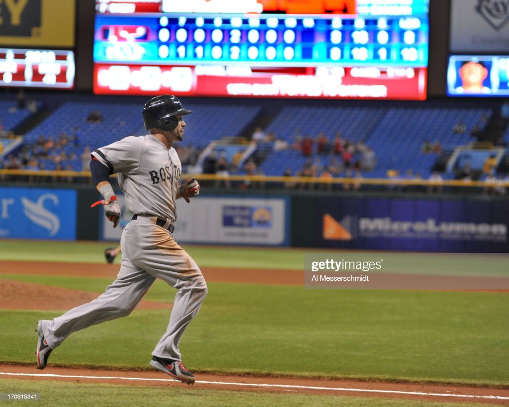 Outfielder <a gi-track='captionPersonalityLinkClicked' href=/galleries/search?phrase=Shane+Victorino&family=editorial&specificpeople=576251 ng-click='$event.stopPropagation()'>Shane Victorino</a> #18 of the Boston Red Sox scores in the 14th inning against the Tampa Bay Rays June 10, 2013 at Tropicana Field in St. Petersburg, Florida. Boston won 10 - 8.