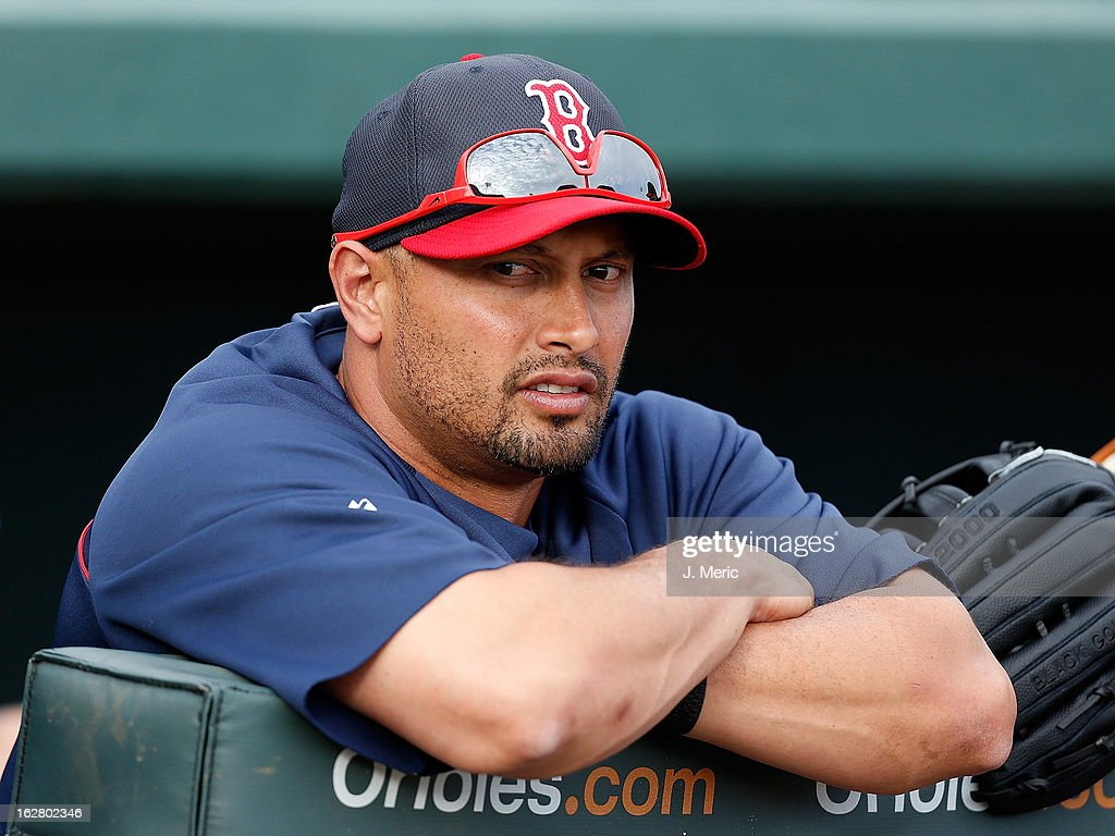 Outfielder Shane Victorino #18 of the Boston Red Sox watches as his team warms up just before the start of the Grapefruit League Spring Training Game against the Baltimore Orioles at Ed Smith Stadium on February 27, 2013 in Sarasota, Florida.
