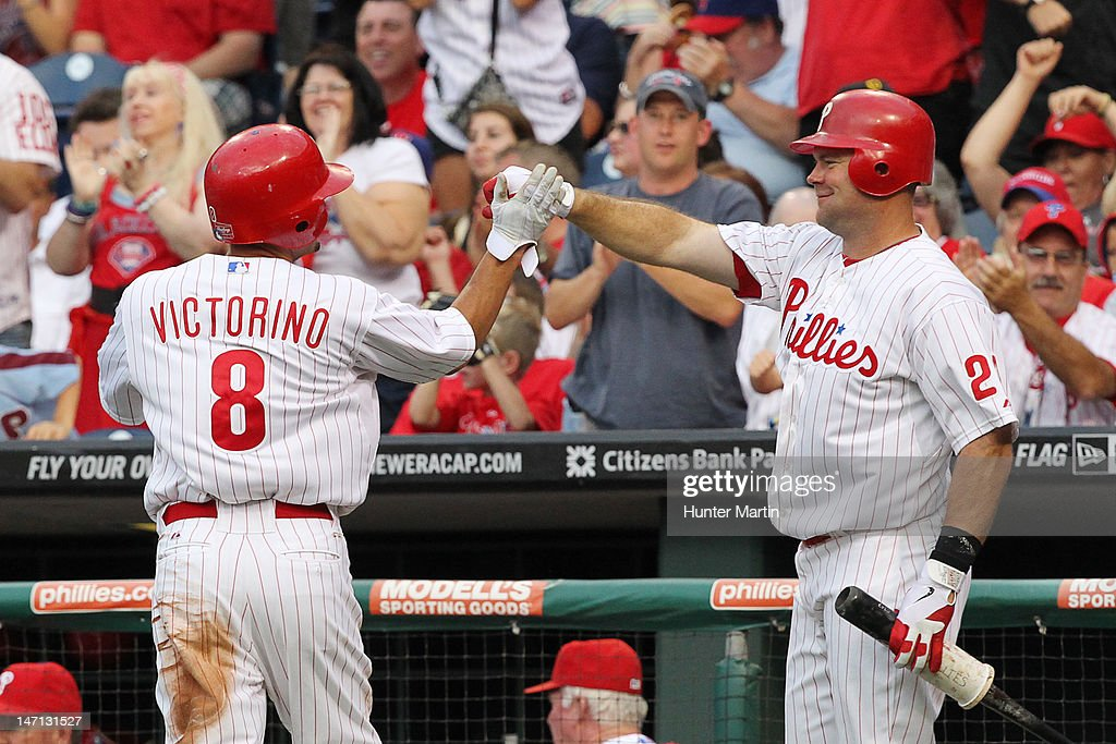Outfielder <a gi-track='captionPersonalityLinkClicked' href=/galleries/search?phrase=Shane+Victorino&family=editorial&specificpeople=576251 ng-click='$event.stopPropagation()'>Shane Victorino</a> #8 of the Philadelphia Phillies is congratulated by first baseman <a gi-track='captionPersonalityLinkClicked' href=/galleries/search?phrase=Ty+Wigginton&family=editorial&specificpeople=211533 ng-click='$event.stopPropagation()'>Ty Wigginton</a> #24 after scoring a run during a game against the Pittsburgh Pirates at Citizens Bank Park on June 25, 2012 in Philadelphia, Pennsylvania.