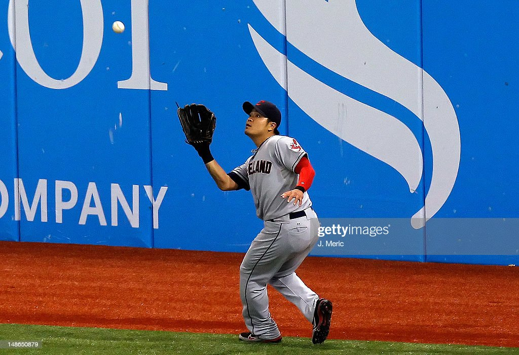 Outfielder <a gi-track='captionPersonalityLinkClicked' href=/galleries/search?phrase=Shin-Soo+Choo&family=editorial&specificpeople=196543 ng-click='$event.stopPropagation()'>Shin-Soo Choo</a> #17 of the Cleveland Indians catches a fly ball against the Tampa Bay Rays during the game at Tropicana Field on July 18, 2012 in St. Petersburg, Florida.