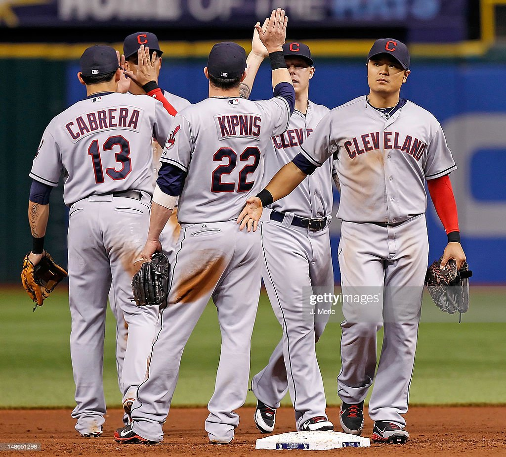 Outfielder <a gi-track='captionPersonalityLinkClicked' href=/galleries/search?phrase=Shin-Soo+Choo&family=editorial&specificpeople=196543 ng-click='$event.stopPropagation()'>Shin-Soo Choo</a> #17 of the Cleveland Indians celebrates victory over the Tampa Bay Rays at Tropicana Field on July 18, 2012 in St. Petersburg, Florida.