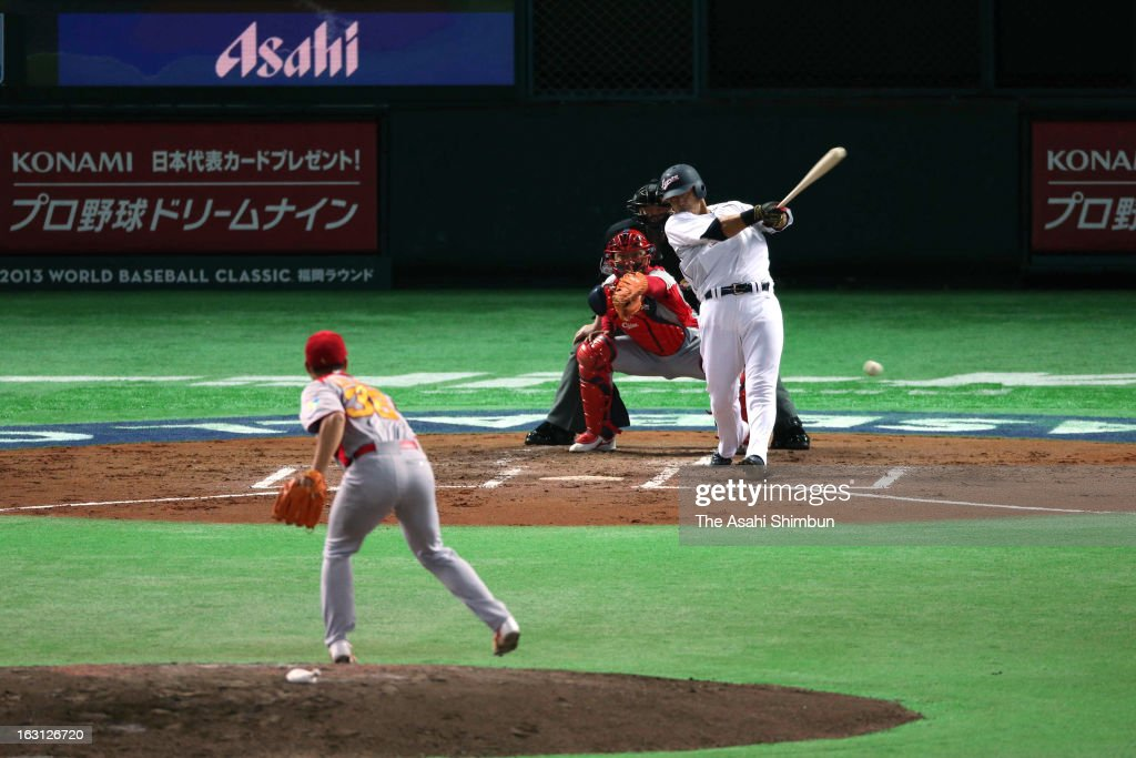 Outfielder <a gi-track='captionPersonalityLinkClicked' href=/galleries/search?phrase=Sho+Nakata&family=editorial&specificpeople=10509678 ng-click='$event.stopPropagation()'>Sho Nakata</a> #13 hits a RBI single in the bottom of the second inning during the World Baseball Classic First Round Group A game between Japan and China at Fukuoka Yahoo! Japan Dome on March 3, 2013 in Fukuoka, Japan.