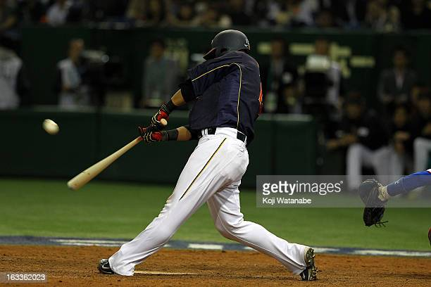 Outfielder Sho Nakata of Japan hits a sacrifice fly in the top half of the tenth inning during the World Baseball Classic Second Round Pool 1 game...
