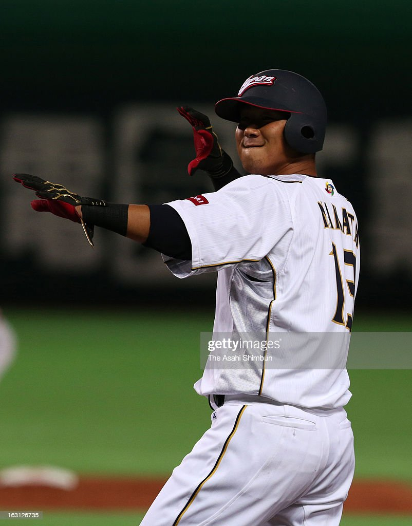 Outfielder Sho Nakata #13 reacts on the first base after hitting a RBI single in the bottom of the second inning during the World Baseball Classic First Round Group A game between Japan and China at Fukuoka Yahoo! Japan Dome on March 3, 2013 in Fukuoka, Japan.