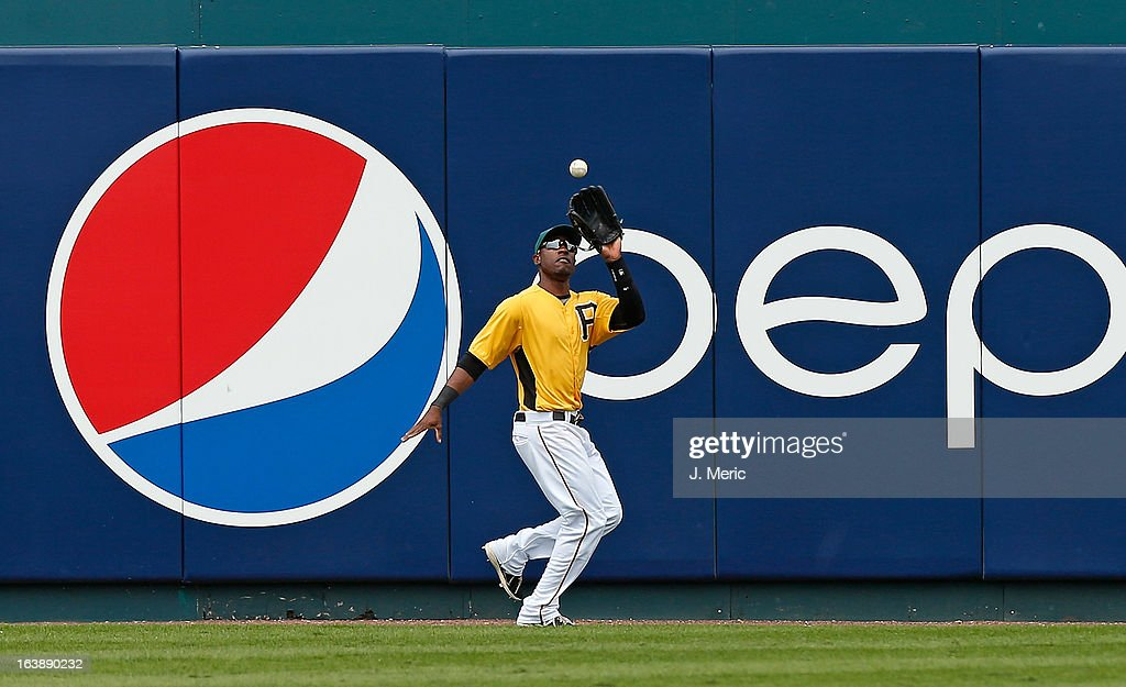 Outfielder <a gi-track='captionPersonalityLinkClicked' href=/galleries/search?phrase=Starling+Marte&family=editorial&specificpeople=7934200 ng-click='$event.stopPropagation()'>Starling Marte</a> #6 of the Pittsburgh Pirates catches a fly ball against the New York Yankees during a Grapefruit League Spring Training Game at McKechnie Field on March 17, 2013 in Bradenton, Florida.