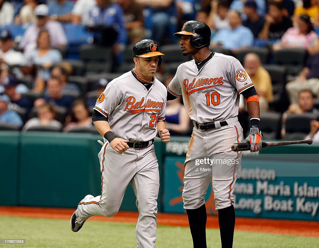 Outfielder Steve Pearce #28 of the Baltimore Orioles is congratulated by Adam Jones after scoring against the Tampa Bay Rays during the game at Tropicana Field on June 9, 2013 in St. Petersburg, Florida.