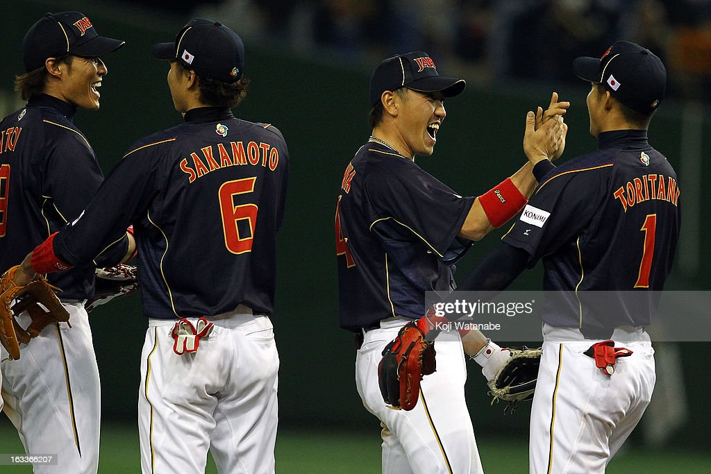 Outfielder Takashi Toritani (1R), Seiichi Uchikawa #24 (2R), Hayato Sakamoto (2L) and Yoshio Itoi (1L) of Japan celebrate after winning the World Baseball Classic Second Round Pool 1 game between Japan and Chinese Taipei at Tokyo Dome on March 8, 2013 in Tokyo, Japan.