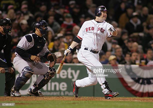 Outfielder Trot Nixon of the Boston Red Sox swings at a New York Yankees pitch during the MLB game at Fenway Park on April 13 2005 in Boston...