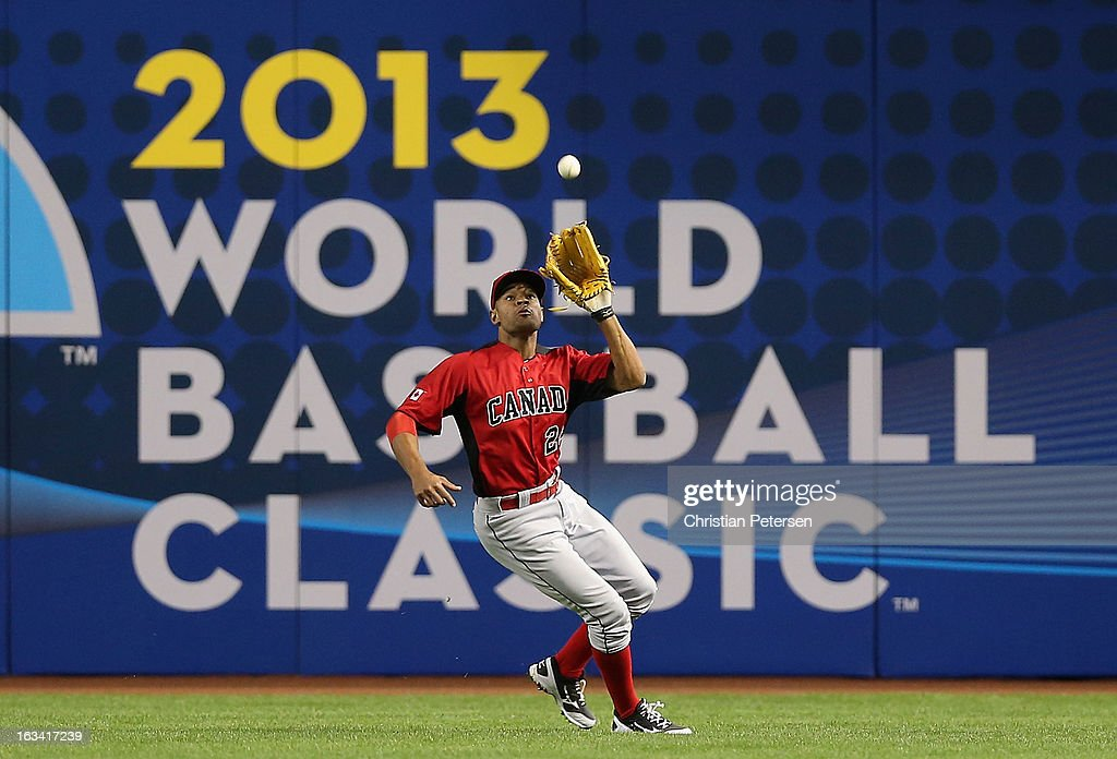 Outfielder Tyson Gillies #24 of Canada catches a fly ball out against Mexico during the World Baseball Classic First Round Group D game at Chase Field on March 9, 2013 in Phoenix, Arizona.