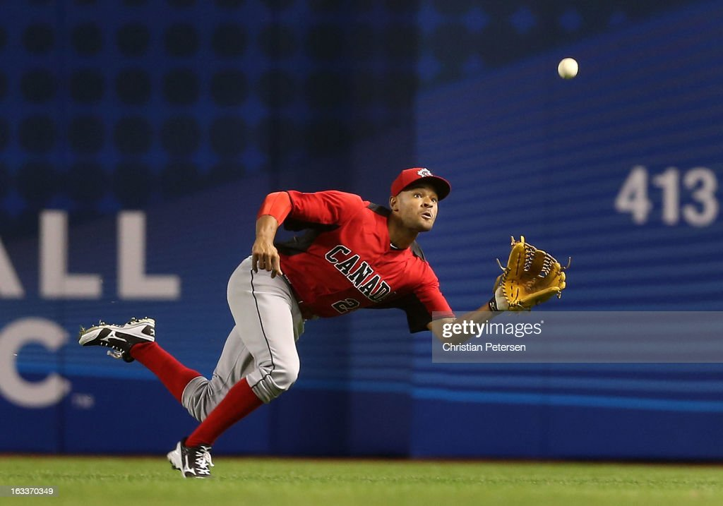 Outfielder Tyson Gillies #24 of Canada makes a diving catch against Italy during the fifth inning of the World Baseball Classic First Round Group D game at Chase Field on March 8, 2013 in Phoenix, Arizona.