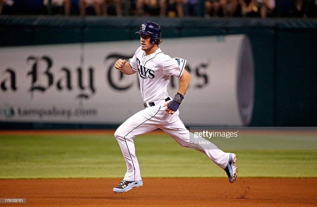 Outfielder <a gi-track='captionPersonalityLinkClicked' href=/galleries/search?phrase=Wil+Myers&family=editorial&specificpeople=7562808 ng-click='$event.stopPropagation()'>Wil Myers</a> #9 of the Tampa Bay Rays advances to third against the Arizona Diamondbacks during the game at Tropicana Field on July 31, 2013 in St. Petersburg, Florida.