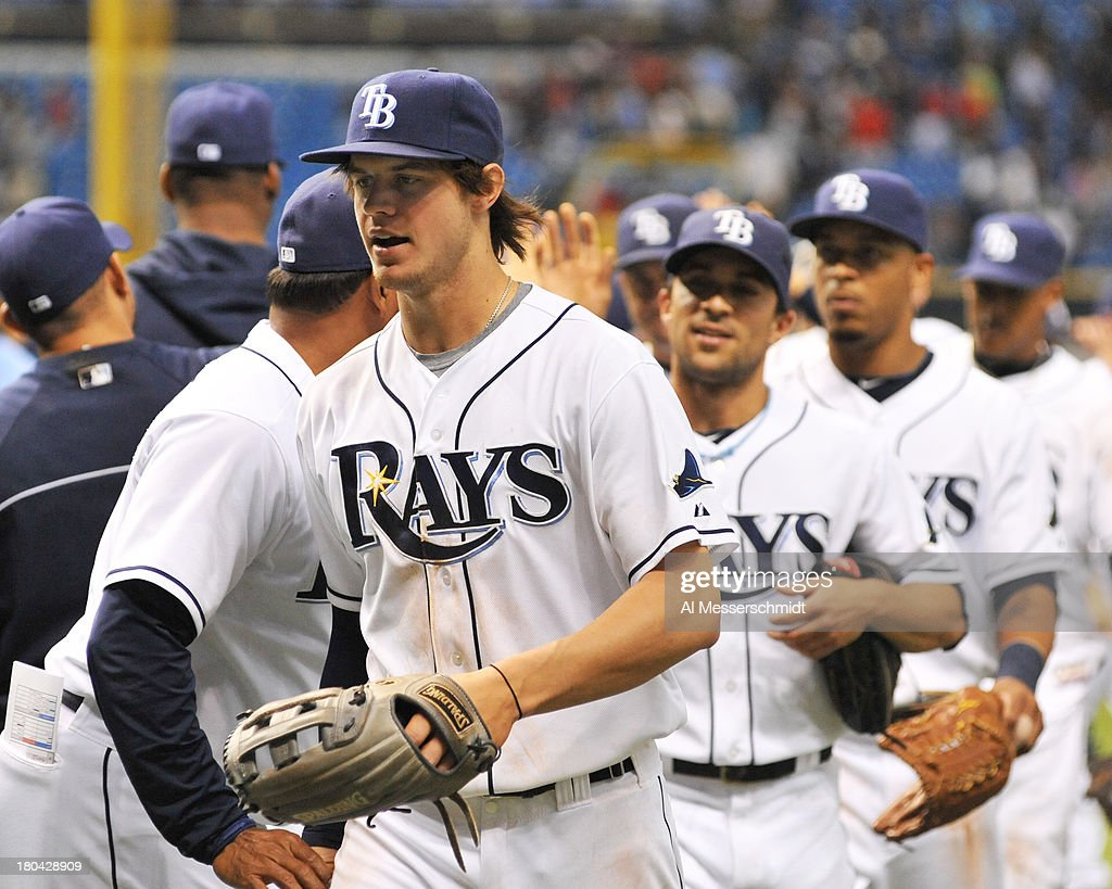 Outfielder Wil Myers #9 of the Tampa Bay Rays celebrates with the team after defeating the Boston Red Sox September 12, 2013 at Tropicana Field in St. Petersburg, Florida. The Rays won 4 - 3.