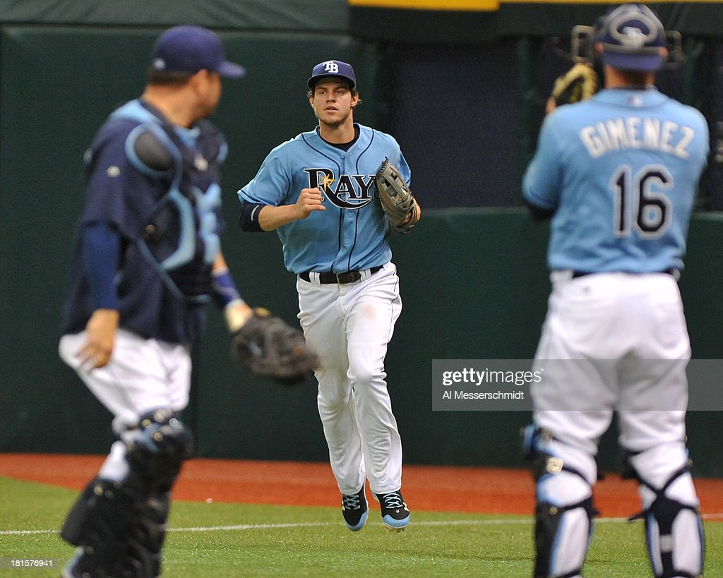 Outfielder <a gi-track='captionPersonalityLinkClicked' href=/galleries/search?phrase=Wil+Myers&family=editorial&specificpeople=7562808 ng-click='$event.stopPropagation()'>Wil Myers</a> #9 of the Tampa Bay Rays runs through the bullpen after catching a ball near the right field line against the Baltimore Orioles September 22, 2013 at Tropicana Field in St. Petersburg, Florida. The Rays won 3 - 1.