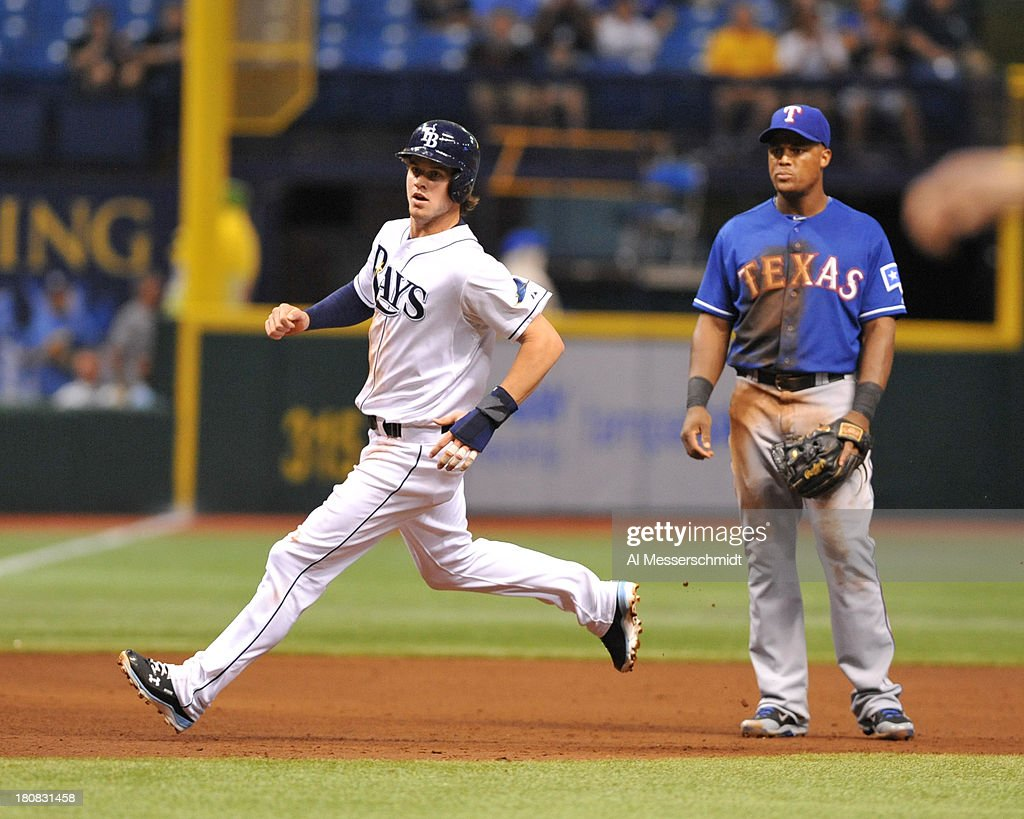 Outfielder <a gi-track='captionPersonalityLinkClicked' href=/galleries/search?phrase=Wil+Myers&family=editorial&specificpeople=7562808 ng-click='$event.stopPropagation()'>Wil Myers</a> #9 of the Tampa Bay Rays runs to 3rd base against the Texas Rangers September 16, 2013 at Tropicana Field in St. Petersburg, Florida.