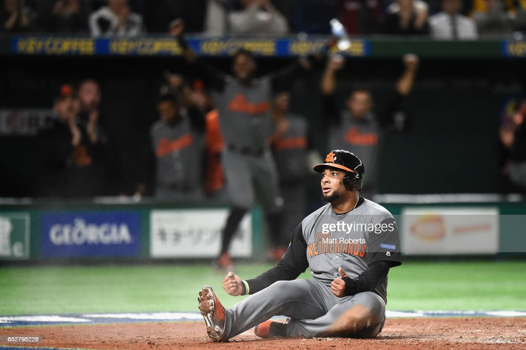 Outfielder Wladimir Balentien #4 of the Netherlands celebrates after scoring a run by a RBI double of Desingated hitter Didi Gregorius #18 of the Netherlands to make it 5-0 in the top of the third inning during the World Baseball Classic Pool E Game Three between Netherlands and Israel at the Tokyo Dome on March 13, 2017 in Tokyo, Japan.