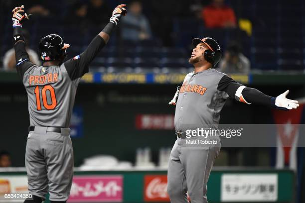 Outfielder Wladimir Balentien of the Netherlands celebrates with Outfielder Jurickson Profar after hitting a three run homerun to make it 30 in the...