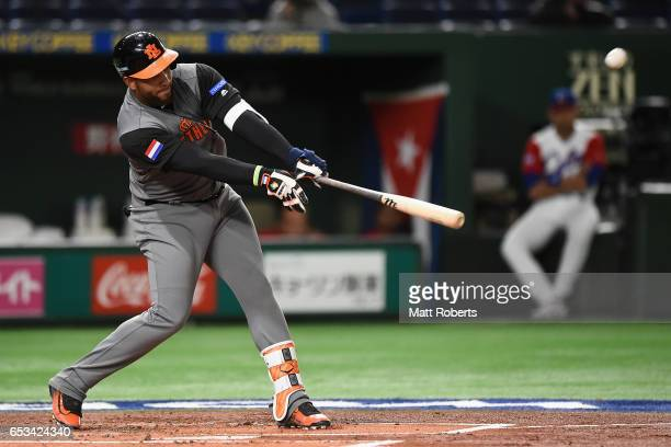 Outfielder Wladimir Balentien of the Netherlands hits a three run homerun to make it 30 in the top of the first inning during the World Baseball...