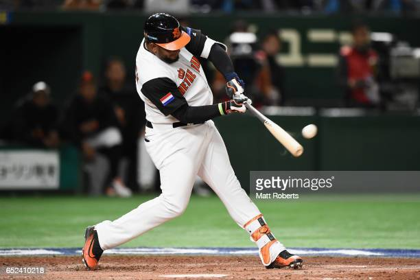 Outfielder Wladimir Balentien of the Netherlands hits a two run homerun to make it 55 in the bottom of the third inning during the World Baseball...