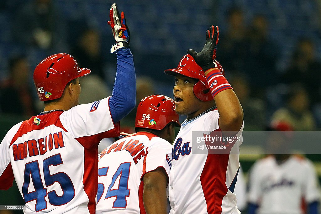 Outfielder Yasmany Tomas #27 of Cuba celebrates after scoring hits a three run home run in the top half of the sixth inning during the World Baseball Classic Second Round Pool 1 game between Chinese Taipei and Cuba at Tokyo Dome on March 9, 2013 in Tokyo, Japan.