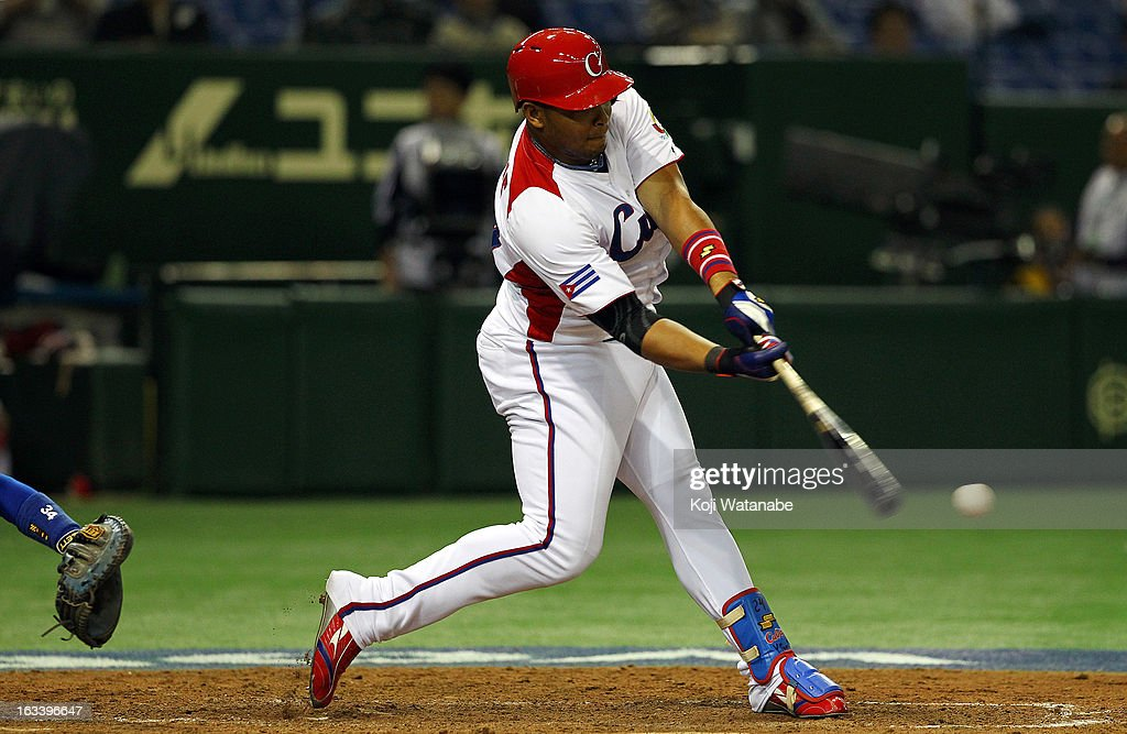 Outfielder Yasmany Tomas #27 of Cuba hits a three run home run in the top half of the sixth inning during the World Baseball Classic Second Round Pool 1 game between Chinese Taipei and Cuba at Tokyo Dome on March 9, 2013 in Tokyo, Japan.