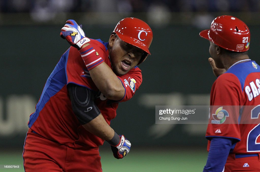 Outfielder Yasmany Tomas # 27 of Cuba reacts after hitting a RBI single in the eighth inning during the World Baseball Classic Second Round Pool 1 game between Cuba and the Netherlands at Tokyo Dome on March 11, 2013 in Tokyo, Japan.