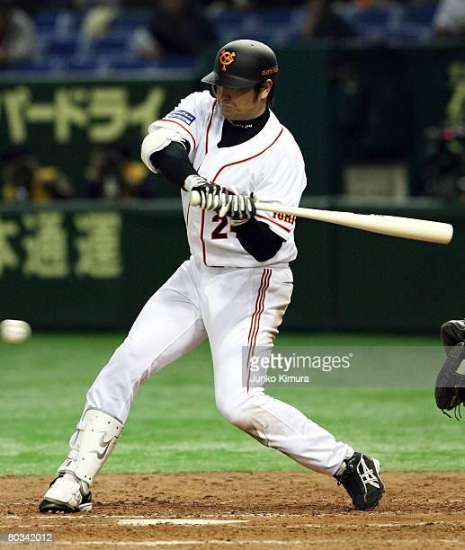 Outfielder Yoshinobu Takahashi of Yomiuri Giants bats during preseason friendly game between Oakland Athletics and Yomiuri Giants at Tokyo Dome on...