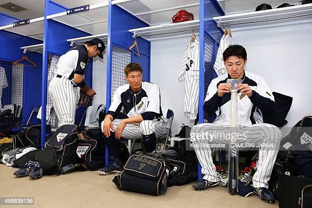 Outfielder Yoshio Itoi and Outfielder Seiichi Uchikawa prepare in the locker room prior to the game one of Samurai Japan and MLB All Stars at Kyocera...