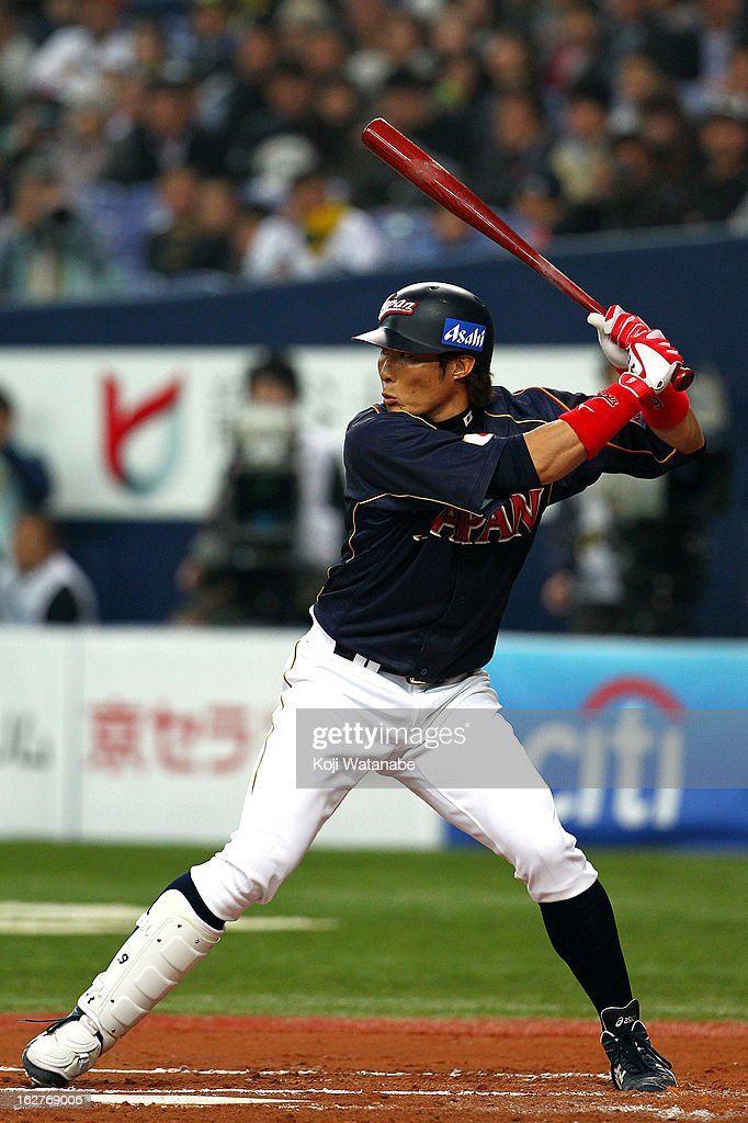 Outfielder Yoshio Itoi #9 of Japan at bat during during the friendly game between Hanshin Tigers and Japan at Kyocera Dome Osaka on February 26, 2013 in Osaka, Japan.