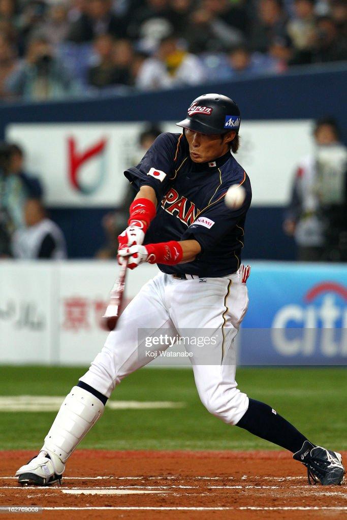 Outfielder Yoshio Itoi #9 of Japan at bat during during the friendly game between Hanshin Tigers and Japan at Kyocera Dome Osaka on February 26, 2013 in Osaka, Japan.