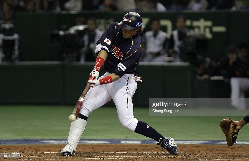 Outfielder Yoshio Itoi of Japan bats during the World Baseball Classic Second Round Pool 1 game between Japan and the Netherlands at Tokyo Dome on...