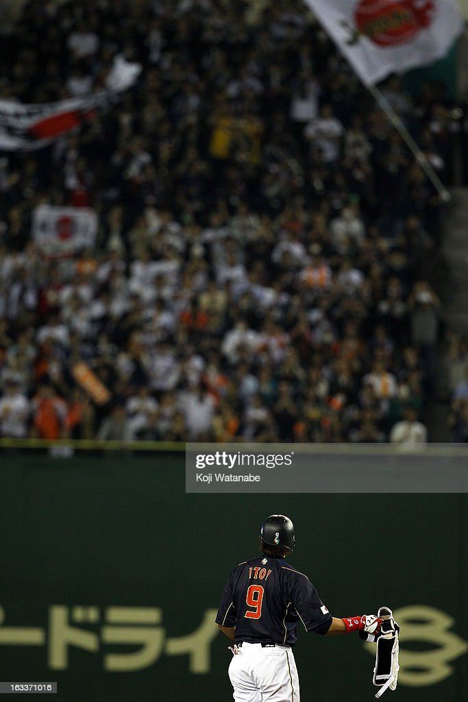 Outfielder Yoshio Itoi of Japan celebrates after a double in the top half of the fourth inning during the World Baseball Classic Second Round Pool 1...