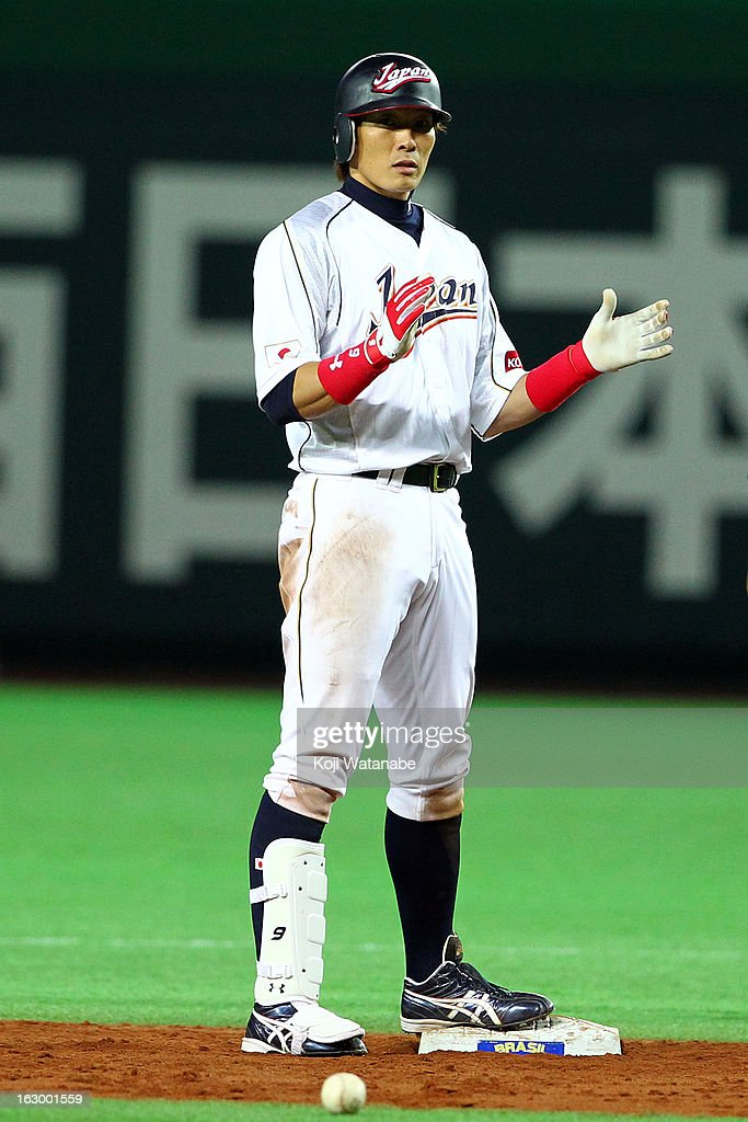 Outfielder Yoshio Itoi of Japan celebrates after in the bottom half of the fifth inning during the World Baseball Classic First Round Group A game...