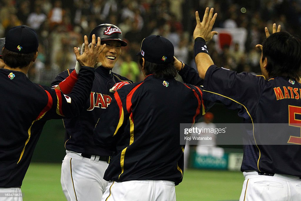 Outfielder Yoshio Itoi #9 of Japan celebrates after scoring a triple homer in the top of the fourth inning during the World Baseball Classic Second Round Pool 1 game between Japan and the Netherlands at Tokyo Dome on March 10, 2013 in Tokyo, Japan.