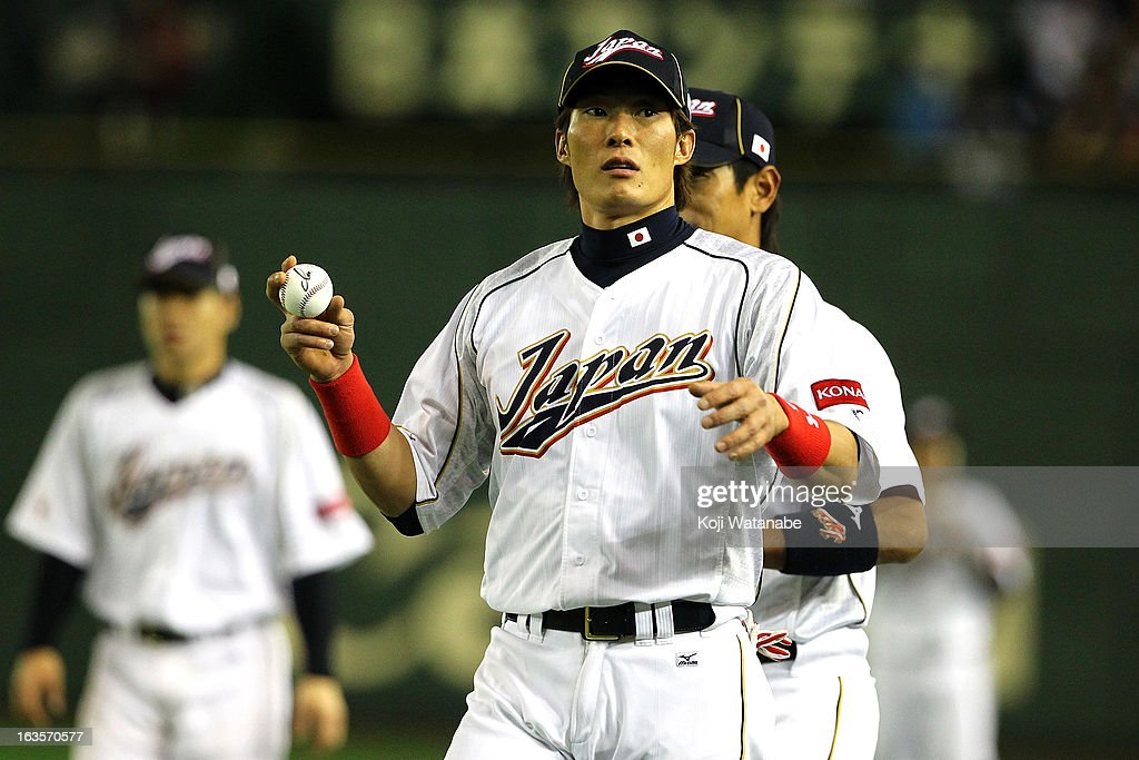 Outfielder Yoshio Itoi of Japan celebrates after winning the World Baseball Classic Second Round Pool 1 game between Japan and the Netherlands at...