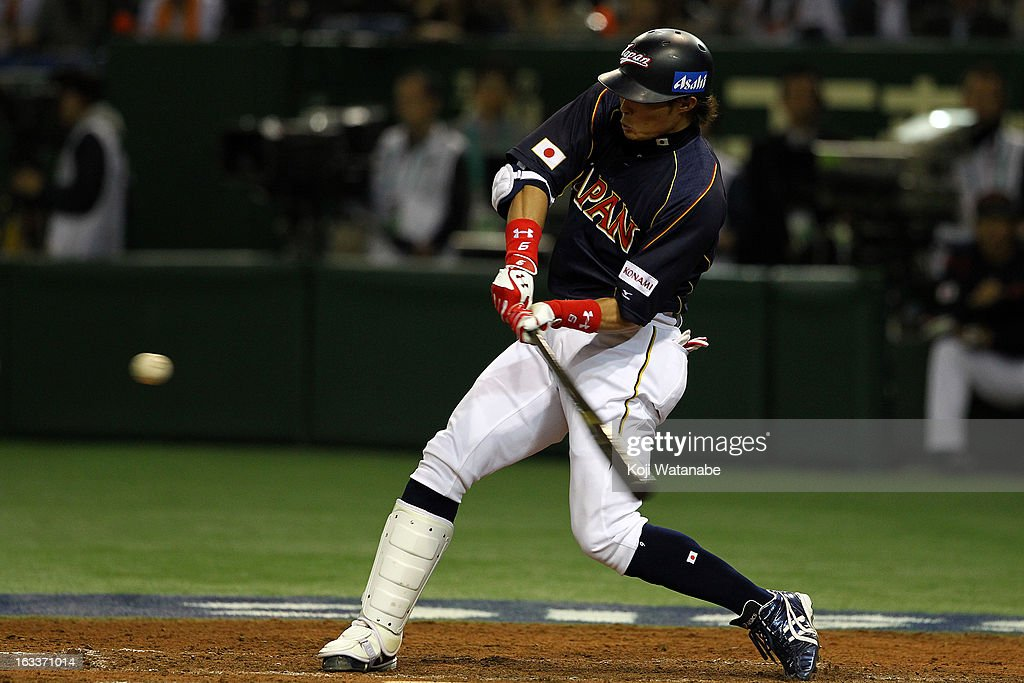 Outfielder Yoshio Itoi of Japan hits a double in the top half of the fourth inning during the World Baseball Classic Second Round Pool 1 game between...