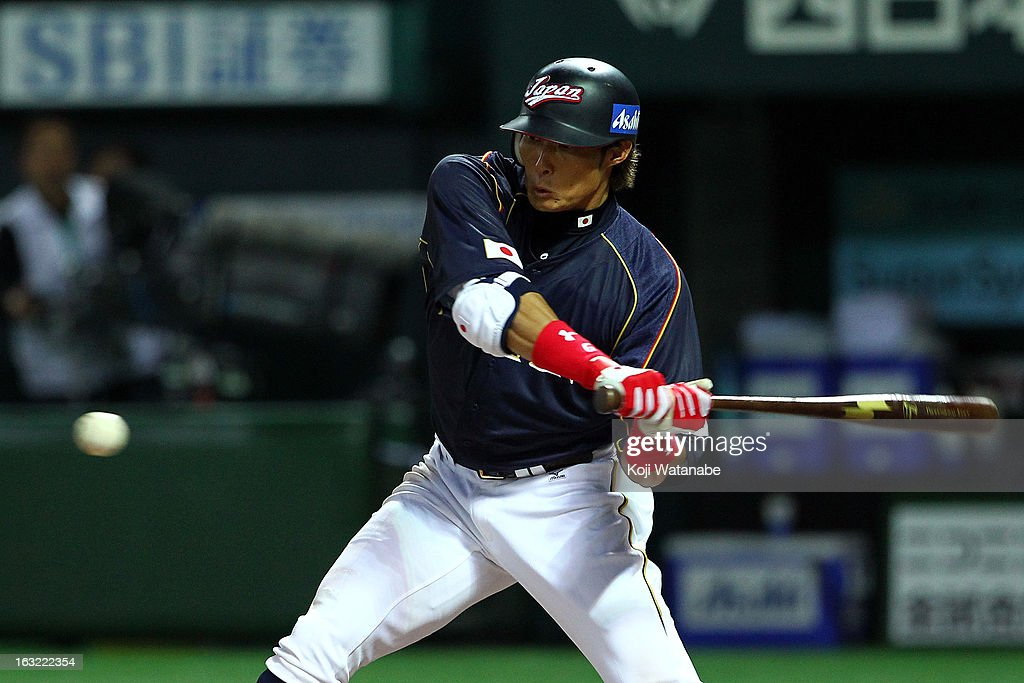Outfielder Yoshio Itoi of Japan hits a single in the top half of the second inning during the World Baseball Classic First Round Group A game between...