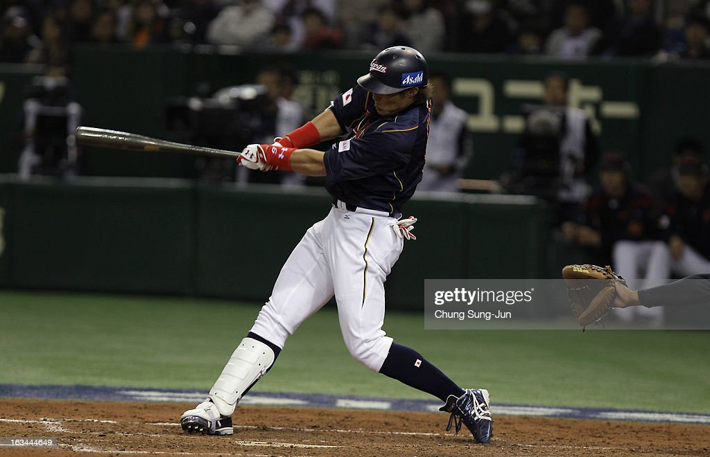 Outfielder Yoshio Itoi # 9 of Japan hits a three run home run top of the fourth inning during the World Baseball Classic Second Round Pool 1 game between Japan and the Netherlands at Tokyo Dome on March 10, 2013 in Tokyo, Japan.