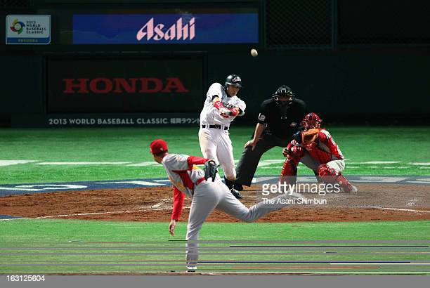 Outfielder Yoshio Itoi of Japan hits a threerun double in the bottom half of the fifth inning during the World Baseball Classic First Round Group A...