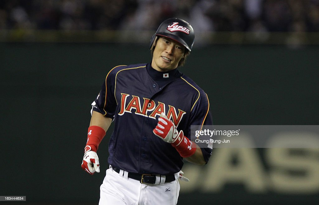 Outfielder Yoshio Itoi # 9 of Japan reacts after hits three run home run top of the fourth inning during the World Baseball Classic Second Round Pool 1 game between Japan and the Netherlands at Tokyo Dome on March 10, 2013 in Tokyo, Japan.