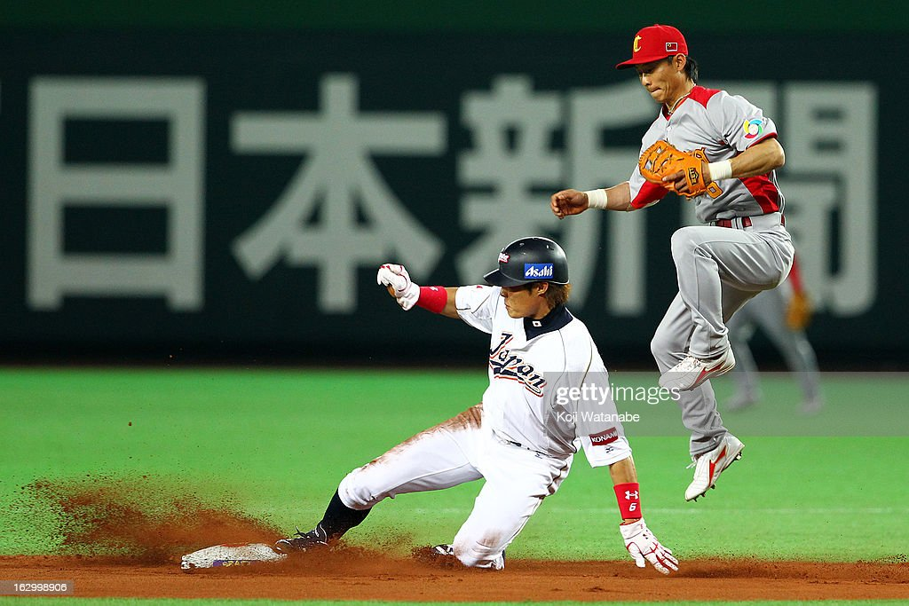 Outfielder Yoshio Itoi #9 of Japan steals a base in the bottom half of the second inning during the World Baseball Classic First Round Group A game between Japan and China at Fukuoka Yahoo! Japan Dome on March 3, 2013 in Fukuoka, Japan.