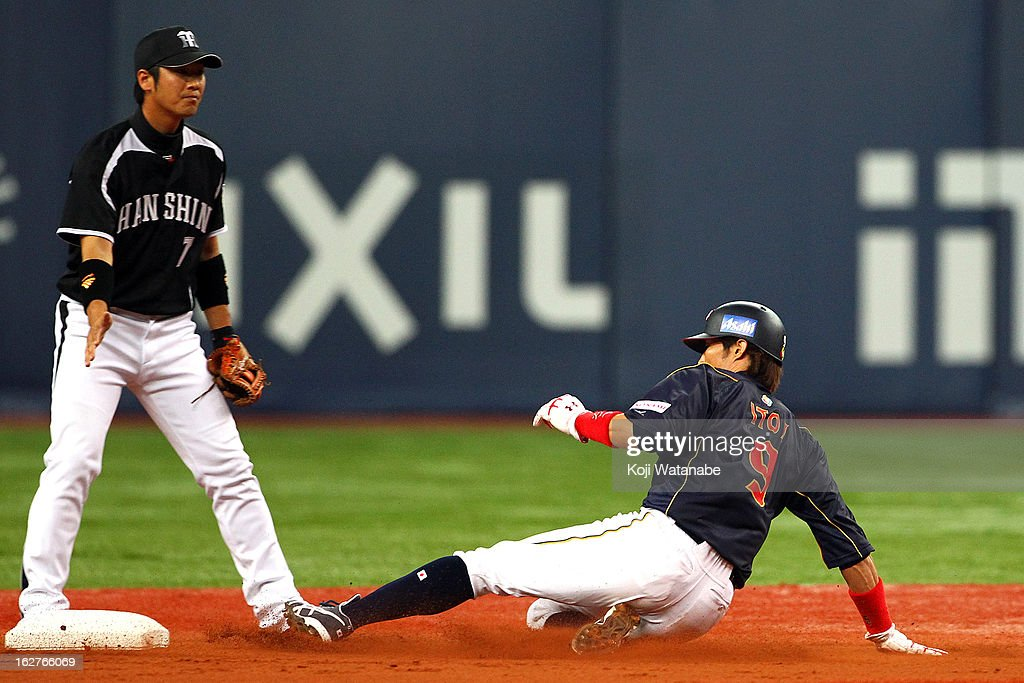 Outfielder Yoshio Itoi #9 of Japan steals a base in the top half of the second inning during the friendly game between Hanshin Tigers and Japan at Kyocera Dome Osaka on February 26, 2013 in Osaka, Japan.