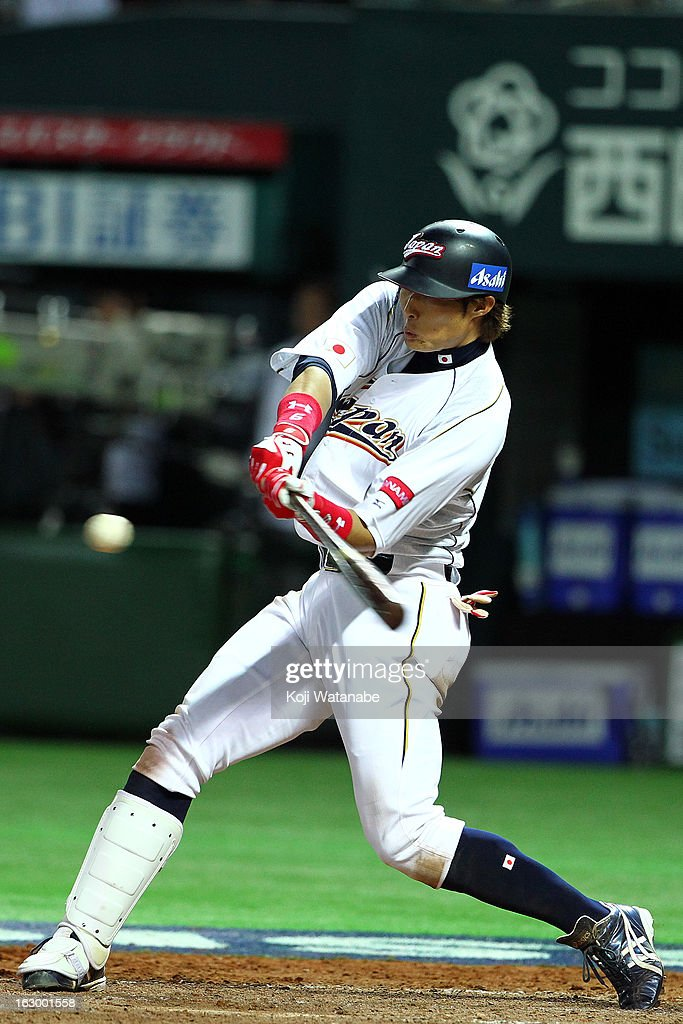 Outfielder Yoshio Itoi of Japan threerun double in the bottom half of the fifhth inning during the World Baseball Classic First Round Group A game...
