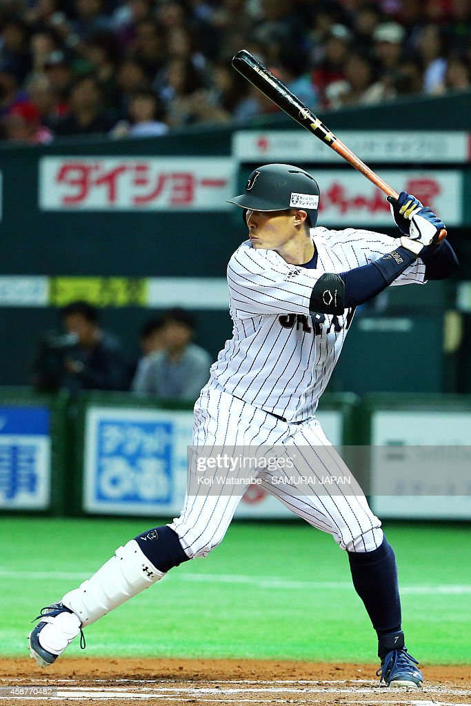 Outfielder Yoshio Itoi of Samurai Japan bats during the friendly match between Samurai Japan and Fukuoka SoftBank Hawks Hokkaido Nipponham Fighters...