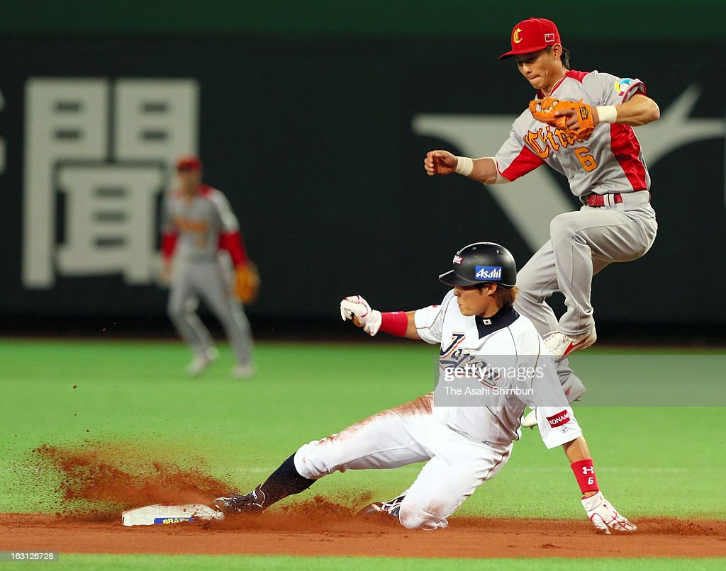 Outfielder Yoshio Itoi steals the second base in the bottom of the second inning during the World Baseball Classic First Round Group A game between...